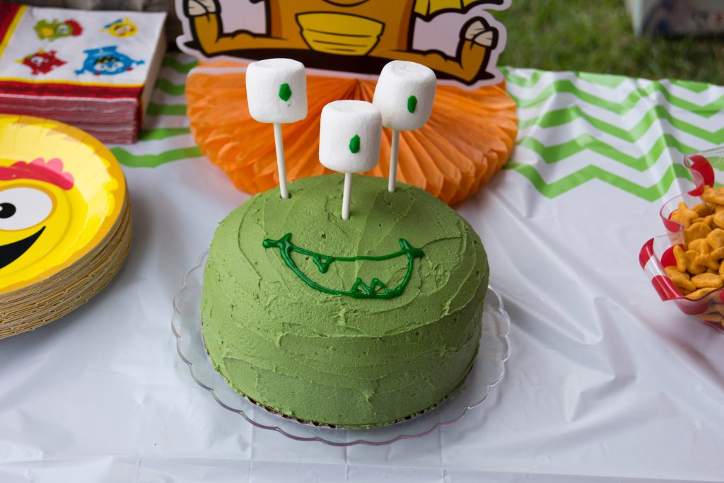Ryan's smash cake with cake-pop holders and marshmallows for the eyes