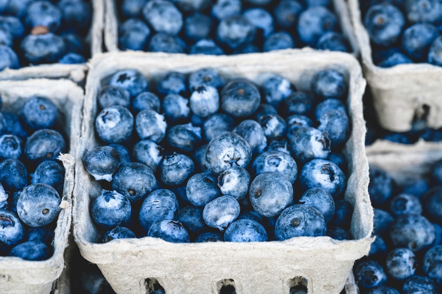 Close up of blueberries in a carton