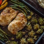 Quick and Easy Teriyaki Chicken Bake on a wooden surface next to a bowl of rice