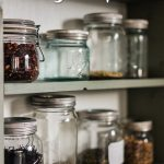 Dried foods in glass jars on a pantry shelf (with simple title overlay)