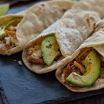 Avocado fish tacos rolled up and ready to eat