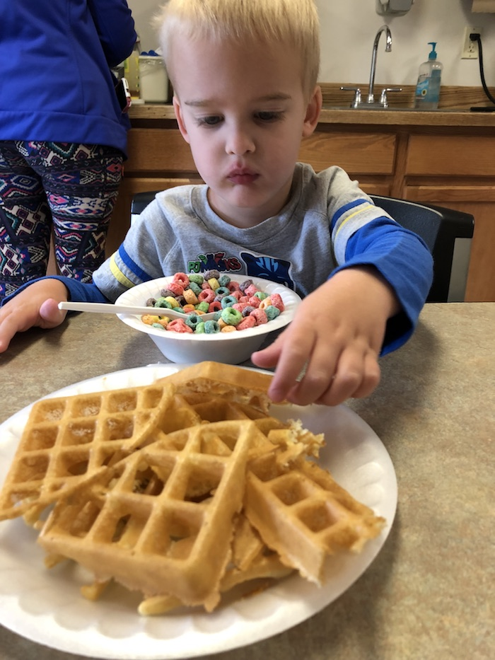 My Vacation in Food: Part 3: Ryan with a bowl of fruity cereal and a plate of waffles