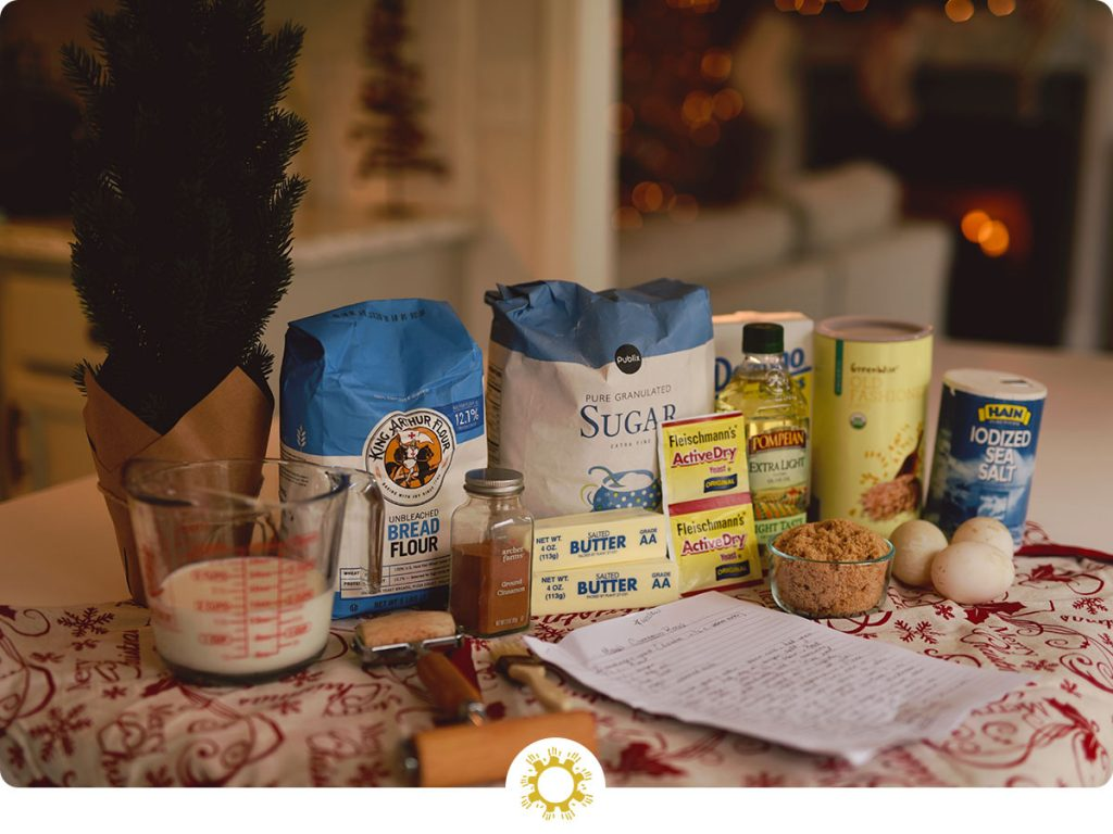 Baking ingredients with a handwritten recipe on a table (with logo overlay)