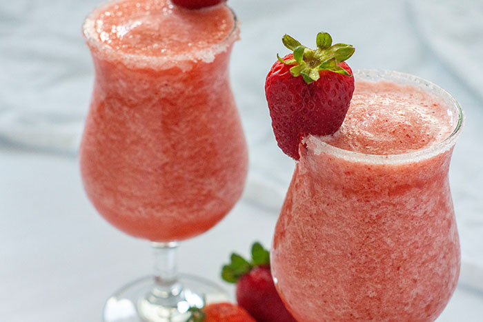 Strawberry Pineapple Daiquiri in glass with strawberry garnish