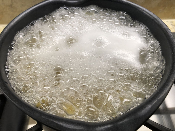 Medium saucepan boiling the orecchiette pasta