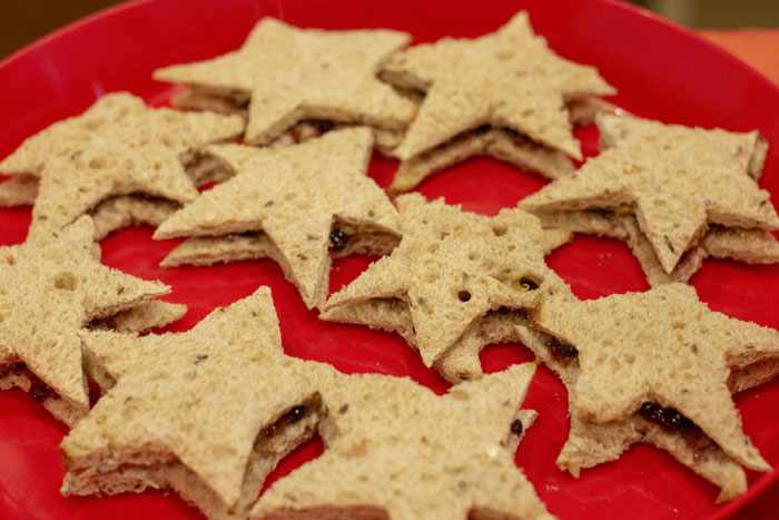 Super Mario star-shaped peanut butter and jelly sandwiches on a red platter