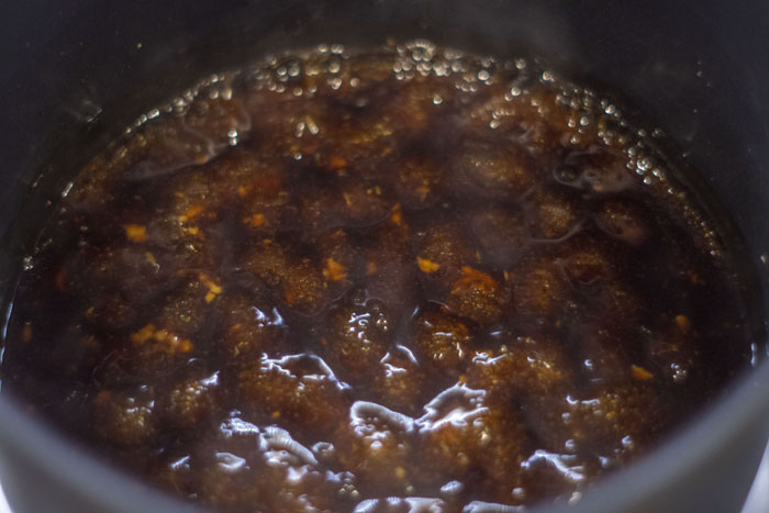 Close up of teriyaki sauce bubbling in a sauce pot