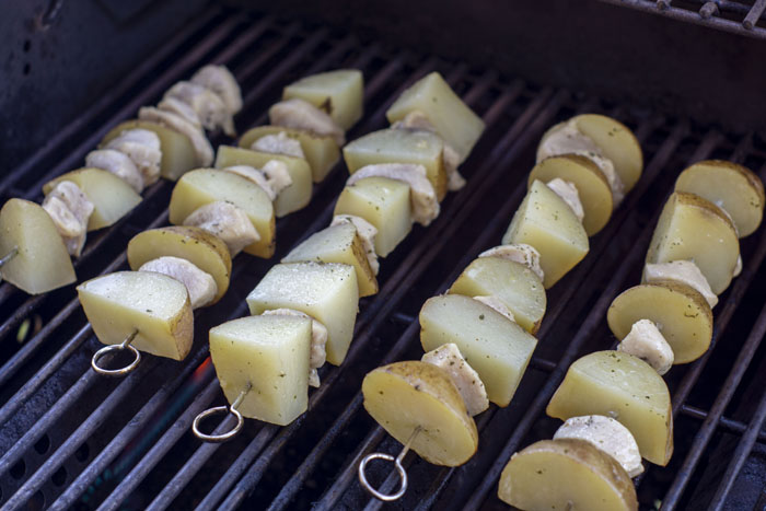 Chicken and potato kabobs on the grill