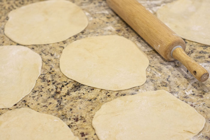 Dough wedges shaped and rolled out to circles
