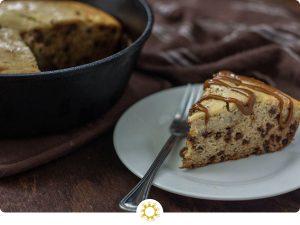 Banana bread cheesecake on plate next to pan