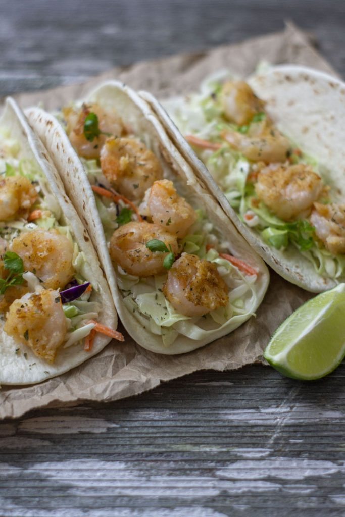 Shrimp Tacos with Coleslaw on a wooden board
