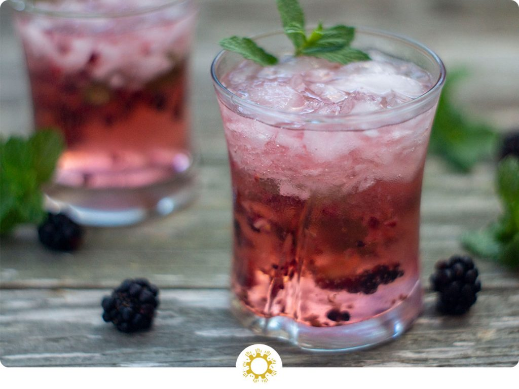 Blackberry Mint Julep in a small glass (with logo overlay)