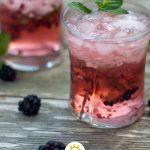 Blackberry Mint Julep in a small glass (with title overlay)