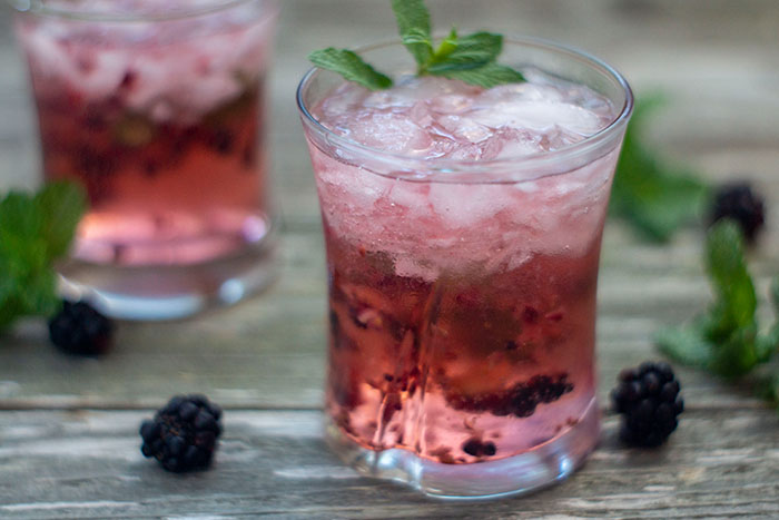 Blackberry Mint Julep in a small glass