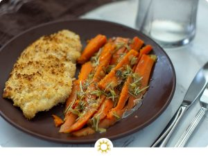 Chicken and Carrots with Rosemary and Lemon Sauce on a brown plate (with logo overlay)
