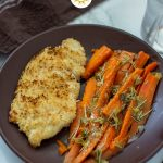 Chicken and Carrots with Rosemary and Lemon Sauce on a brown plate (with title overlay)