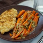 Chicken and Carrots with Rosemary and Lemon Sauce on a brown plate