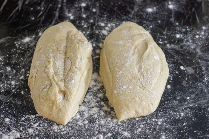 Two balls of dough on a floured surface