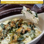 Chicken and Spinach Casserole with Cream Cheese in a white bowl with a fork lifting one piece out with a brown and white towel behind all on a wooden surface (with title overlay)