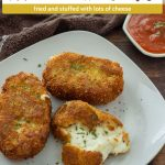 Fried Mozzarella Cakes on a square white plate next to a white bowl with marinara sauce with a brown and white towel behind all on a wooden surface (with title overlay)