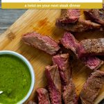 Slices of brown sugar steak next to a white bowl of green chimichurri sauce on a bamboo cutting board on a wooden surface (with title overlay)