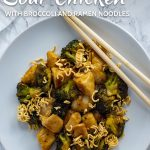 Sweet and Sour Chicken and Broccoli with Ramen Noodles on a round white plate with wooden chopsticks all on a white and grey marble surface (with title overlay)