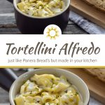 Tortellini alfredo in a round brown bowl with a loaf of bread on a bamboo tray with a white and brown towel behind all on a wooden surface (with title overlay)