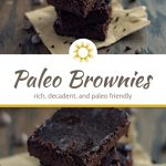 Stack of 3 paleo brownies on a piece of brown parchment paper with brownie crumbs and chocolate chips around and a brown towel behind all on a wooden surface (with title overlay)