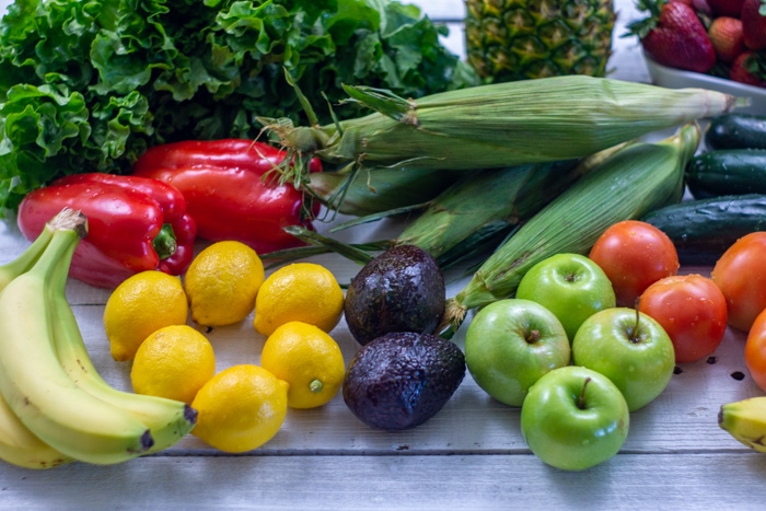 Fruits and vegetables on a white wooden surface