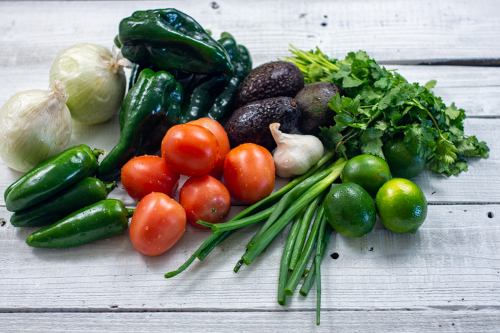 Various vegetables on a white wooden surface