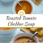 Roasted Tomato and Cheddar Soup in a round white bowl on a round white plate next to another bowl of soup and toasted bread on a bamboo board all on a white wooden surface (with title overlay)