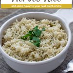 Herbed rice in a round whtie bowl with a grey placemat and stainless steel fork on a wooden surface (with title overlay)